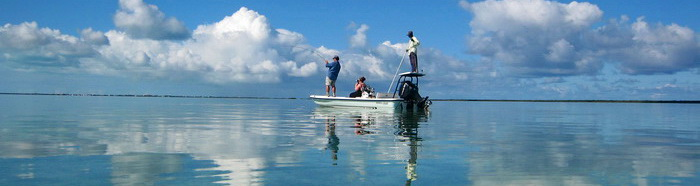 D.B.Tours bonefishing with island guide Darin Bain on the bonefishing flats of Provo Turks and Caicos Islands  photo by Marta Morton